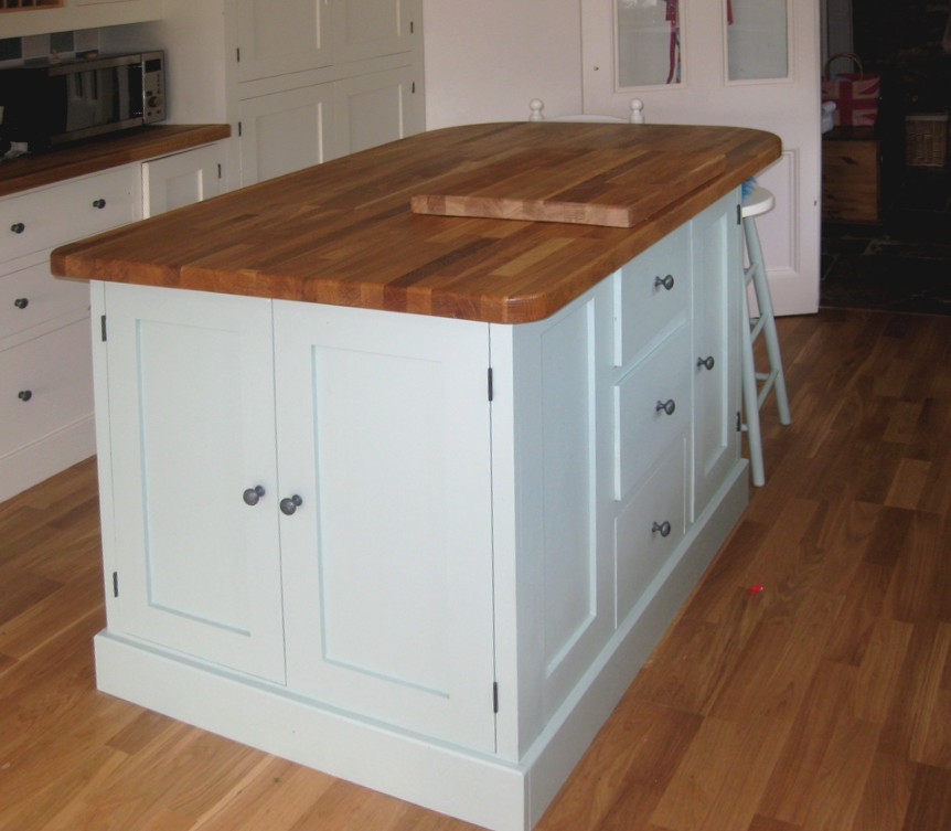 a blue painted kitchen island with breakfast bar and stools