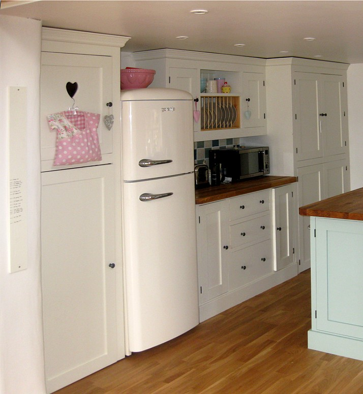 a painted pine kitchen with heart cut out