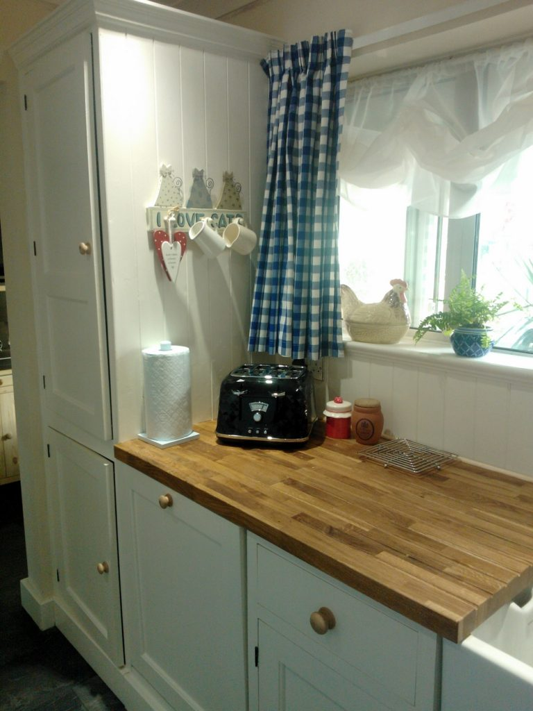 a made to measure boiler cupboard in a kitchen