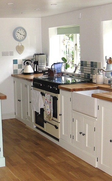 painted kitchen units with a range cooker