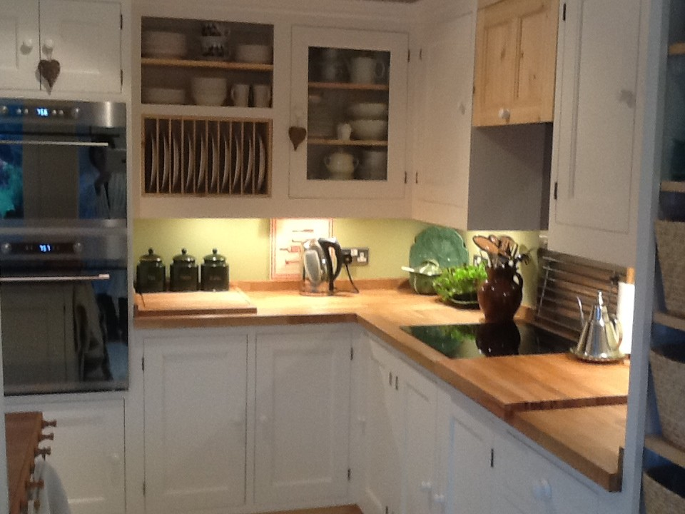 a pine painted kitchen with solid wood worktops
