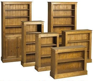 a group of pine bookcases of various sizes