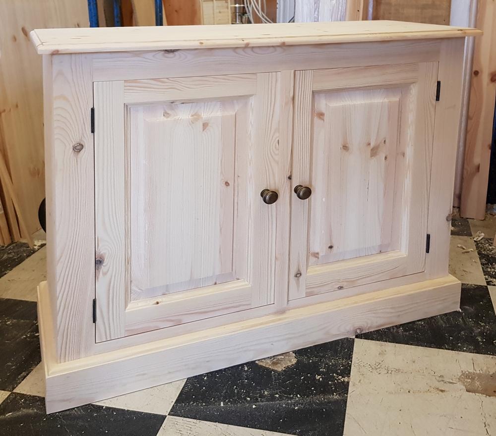 A pine cupboard made by Pegasus pine, Northampton.