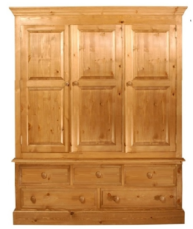 a pine wardrobe on a bank of five drawers which is 60 inches long
