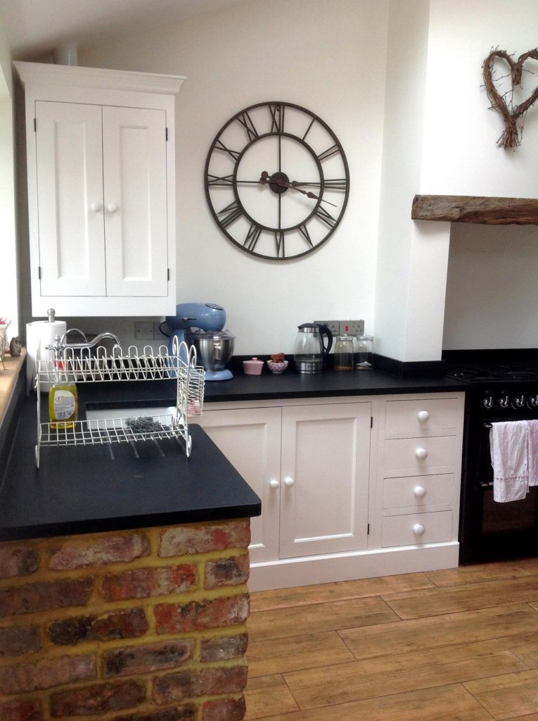 a painted solid wood kitchen painted white